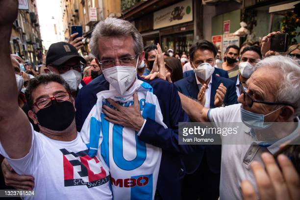 Gaetano Manfredi posing with Maradona's shirt during a visit to the Pignasecca market on June 15, 2021 in Naples, Italy. The political head of the 5...