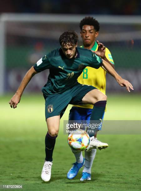 Gaetano Oristanio of Italy looks to break past Talles Costa of Brazil during the FIFA U-17 World Cup Quarter Final match between Italy and Brazil at...