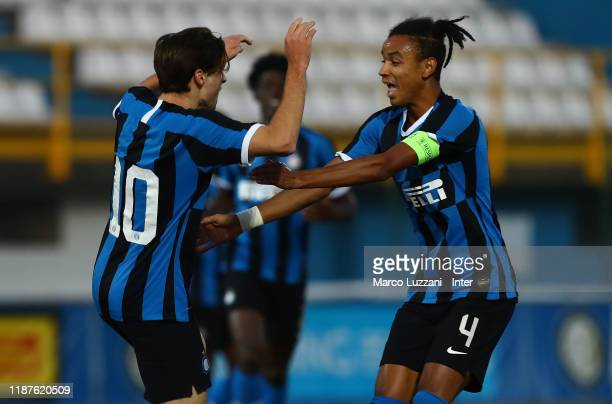 Gaetano Pio Oristanio of FC Internazionale celebrates with his team mate Thomas Schiro after scoring the opening goal during the UEFA Youth League...
