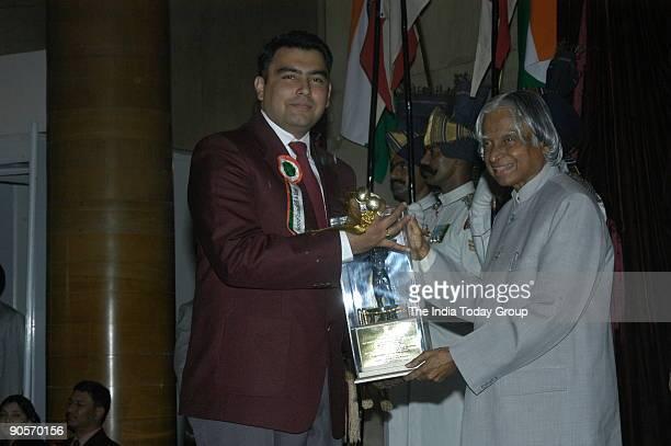 Gagan Narang Receiving the Arjuna Award from APJ Abdul Kalam President of India at Sports and Adventure Awards2005 function in New Delhi India