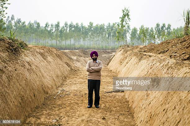 Gagandeep Singh a development officer for Yamuna Nagar district stands for a photograph at the site of a newlydug canal along the purported ancient...