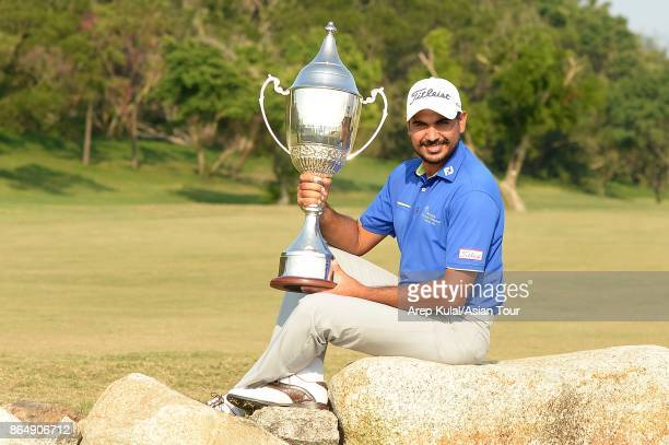 Gaganjeet Bhullar of India pose with trophy after winning the Macao Open 2017 at Macau Golf and Country Club on October 22 2017 in Macau Macau