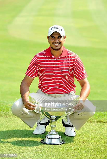 Gaganjeet Bhullar of India poses with the winner's trophy on the second day of round four of the Yeangder Tournament Players Championship at Linkou...