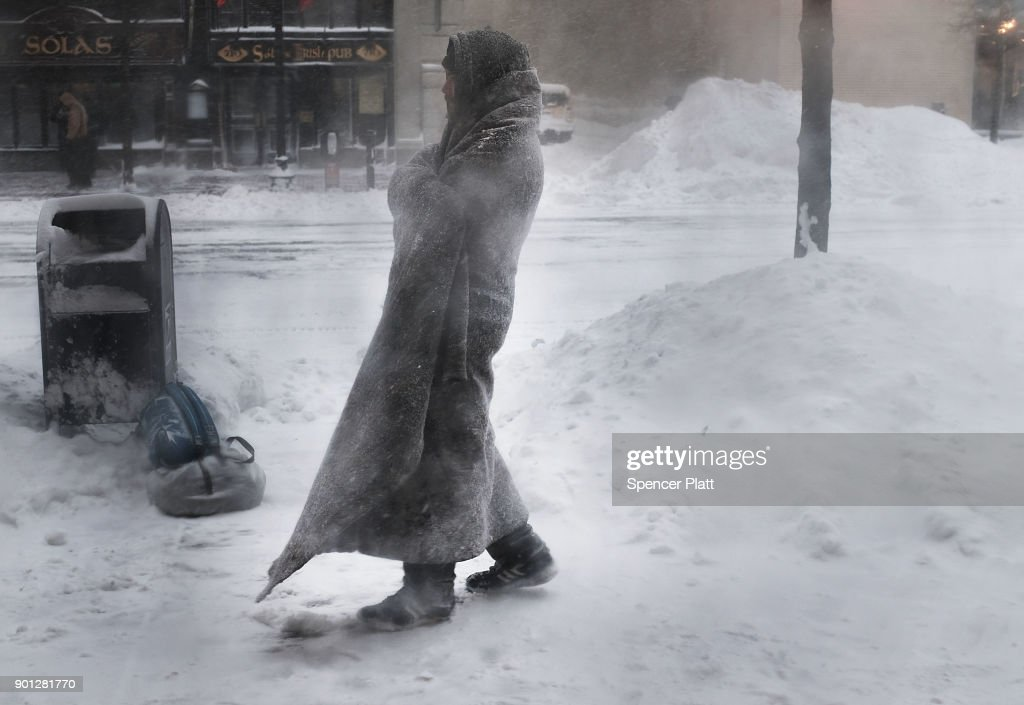 Gage, who is homeless, pauses outside of a coffee shop on the streets of Boston as snow falls from a massive winter storm on January 4, 2018 in Boston, United States. Schools and businesses throughout the Boston area are closed as the city is expecting over a foot of snow and blizzard like conditions throughout the day.