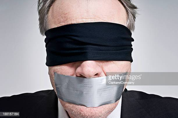 Gagged and Blindfolded Businessman