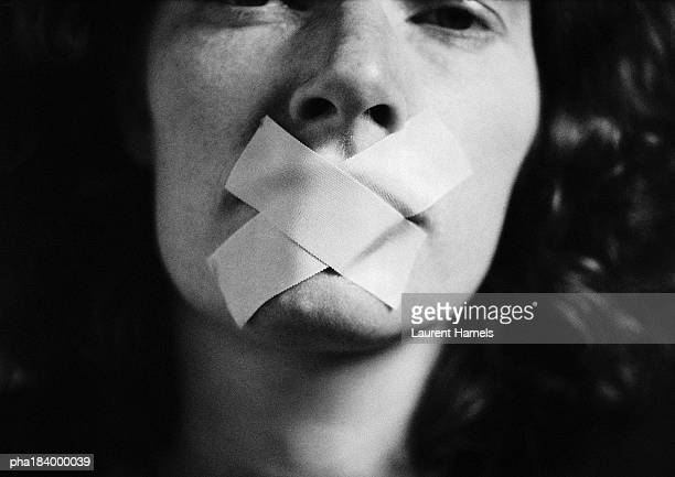 gagged woman, close-up, blurred - violenza foto e immagini stock