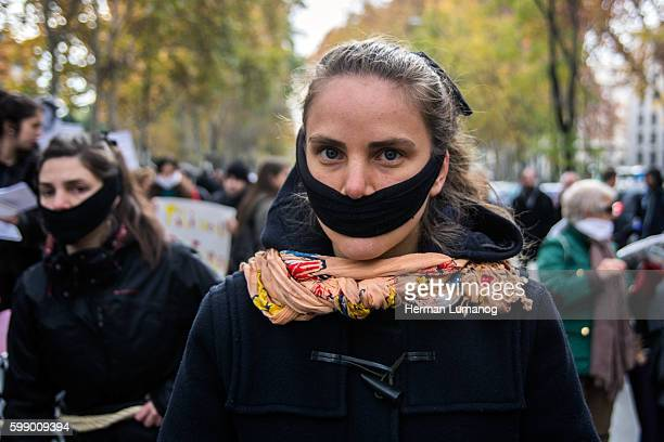 A gagged woman protesting against Gag Law Social collectives have gathered in Madrid to protest against Citizen Security Law also known as Gag Law...