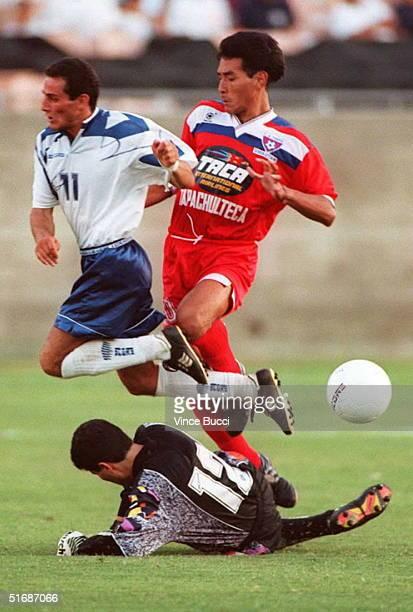 Gagik Margarian of the Shirag Gumri soccer team from Armenia and Raul Diaz Arce of El Salvador's Luis Angel Firpo team jump up to avoid Armenian goal...