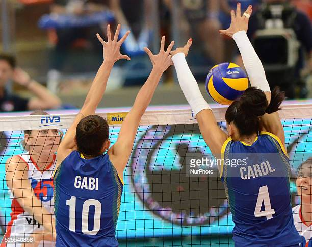 Gagriela Braga Guimaraes and Ana Carolina Da Silva of Brazil attemp to block the ball from Serbia player during their FIVB World Grand Prix...