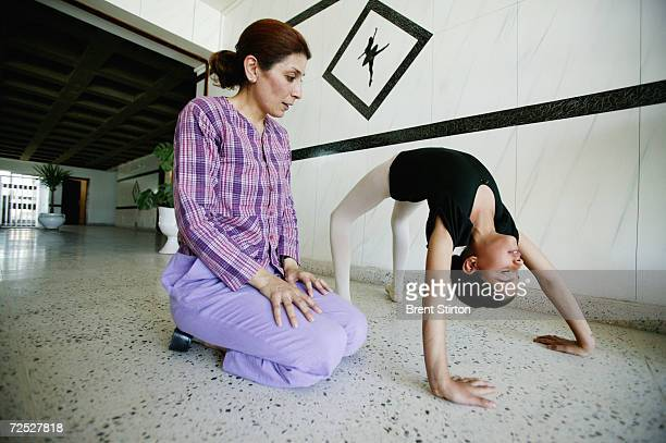 Gahda Monther Salim a ballet teacher at the School of Music and Ballet instructs 11yearold Aya Mohaned one of her students who she is coaching during...