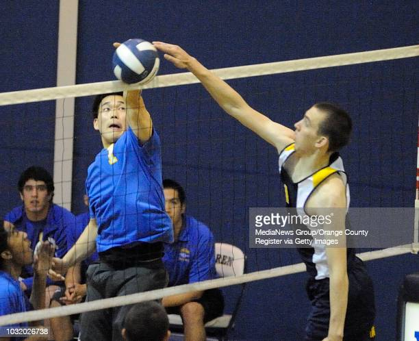 DOWNEY CALIF USA Gahr's Andrew Kim and Warren's Dean Kendall both go after the ball during their game in Downey Calif on April 7 2011