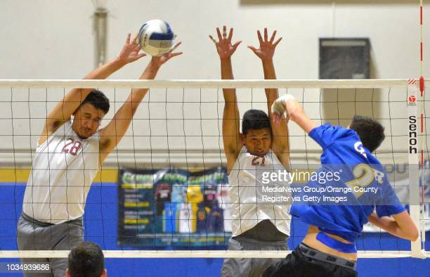 Gahr's Zachary Ayala right hits into the block of Paramount's Michael Duran left and Adrian Flores in Artesia CA on Tuesday April 26 2016...
