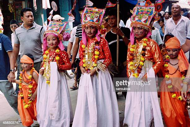 gai jatra procession - nepalese ethnicity stock pictures, royalty-free photos & images