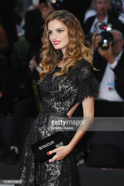 Gaia Amaral walks the red carpet ahead of the 'At Eternity's Gate' screening during the 75th Venice Film Festival at Sala Grande on September 3 2018...