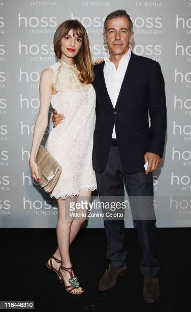 Gaia Bermani Amaral and Costan Herm attend the Hoss Intropia Flagship Store Opening on July 7 2011 in Rome Italy