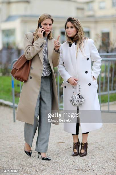 Gaia Repossi and Miroslava Duma attend the Christian Dior show as part of the Paris Fashion Week Womenswear Fall/Winter 2017/2018 on March 3, 2017 in...
