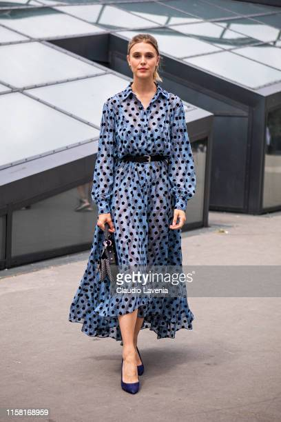 Gaia Weiss, wearing a blue printed dress, black belt, blue heels and Kenzo printed bag, is seen outside Kenzo fashion show on Day 6 during the Paris...