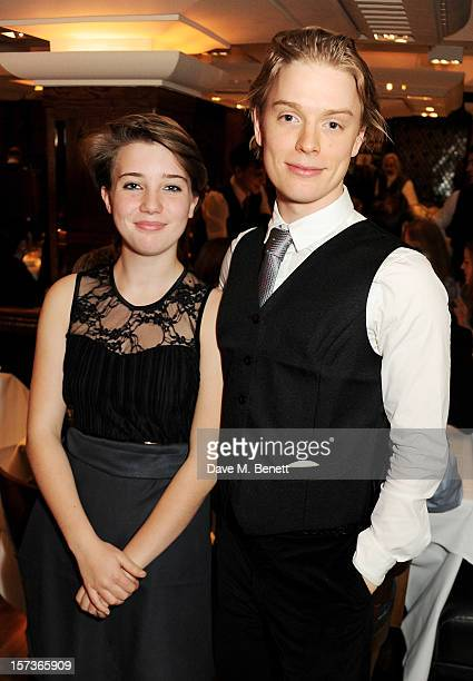 Gaia Wise and actor Freddie Fox working as a barman attend One Night Only at The Ivy featuring 30 stage and screen actors working as staff during...