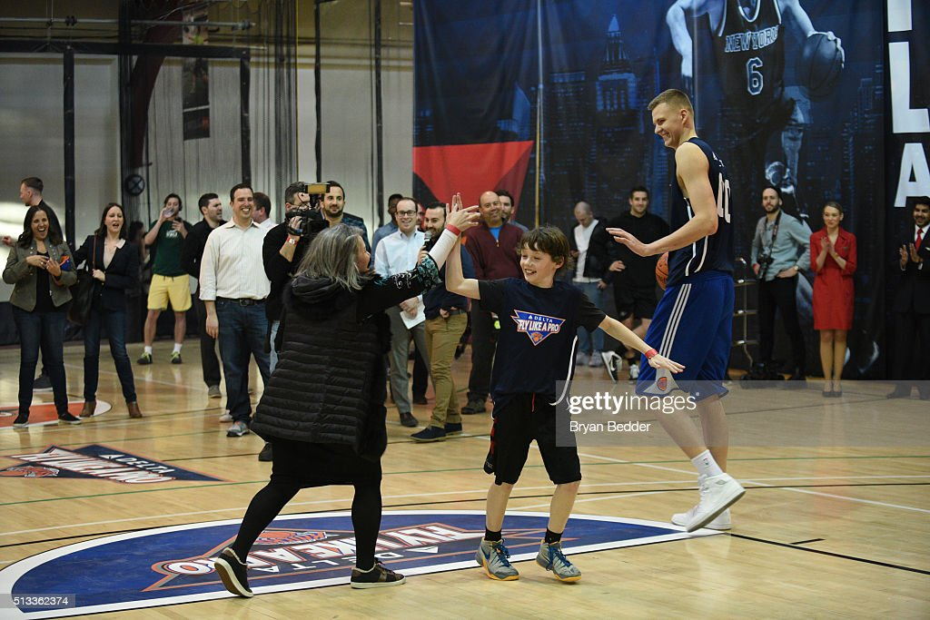Gail A. Grimmett, Liam Kennelly and Kristaps Porzingis celebrate Delta Air Lines Fly Like a Pro campaign with a H-O-R-S-E competition at Chelsea Piers in New York City on March 2, 2016.