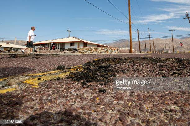 Gail Austin surveys the damage around one of his homes July 7 2019 in Trona He has spent almost his entire life in town Residents of Trona were still...