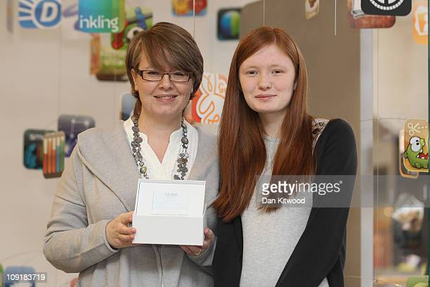 Gail Davis and Daughter Emma Davis 17 from Orpington in Kent pose for pictures at the Apple Store in the Bluewater Shopping Centre after winning the...