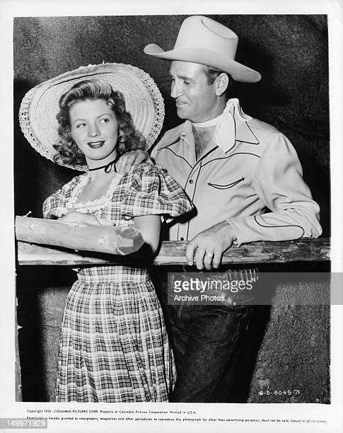 Gail Davis and Gene Autry publicity portrait for the film 'Wagon Team' 1952