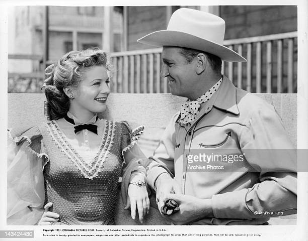 Gail Davis and Gene Autry sharing smiles in a scene from the film 'Valley Of Fire' 1951