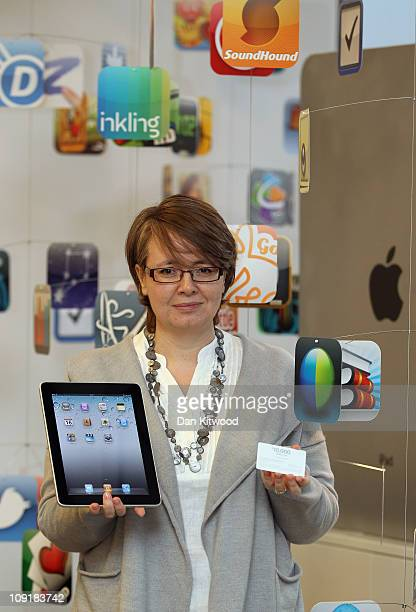 Gail Davis from Orpington in Kent poses for pictures at the Apple Store in the Bluewater Shopping Centre after winning the App Store Countdown to 10...