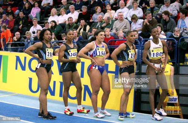 Gail Devers Chandra Sturrup Diane Allahgreen Kelli White and Juliet Campbell await the result of the Women's 60m Final