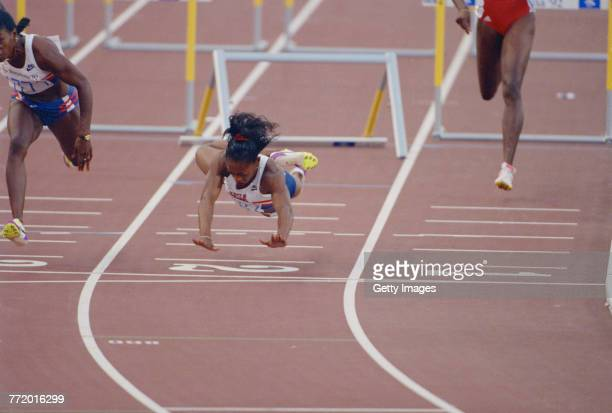 Gail Devers of the United States stumbles and falls across the finishing line after clipping the10th hurdle in the Women's 100 metres Hurdles final...
