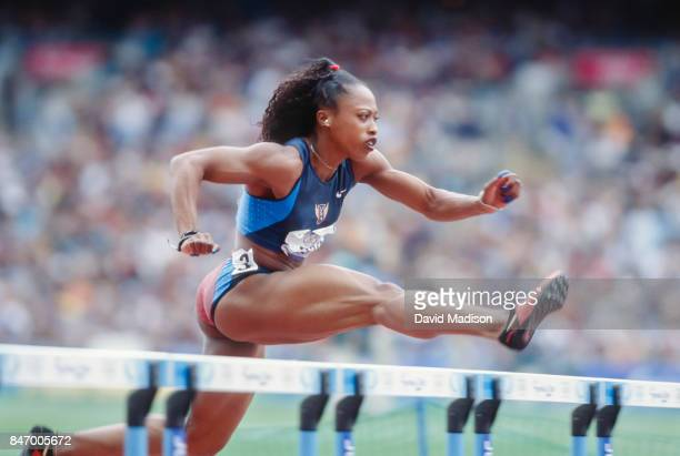 Gail Devers of the USA competes in the first round of the Women's 100 meter hurdles event of the 2000 Summer Olympics track and field competition on...