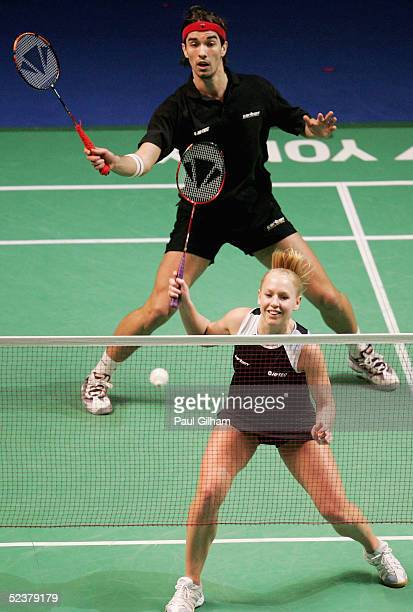 Gail Emms and Nathan Robertson of England on their way to victory against Sudket Prapakamol and Saralee Thungthongkam of Thailand during the...