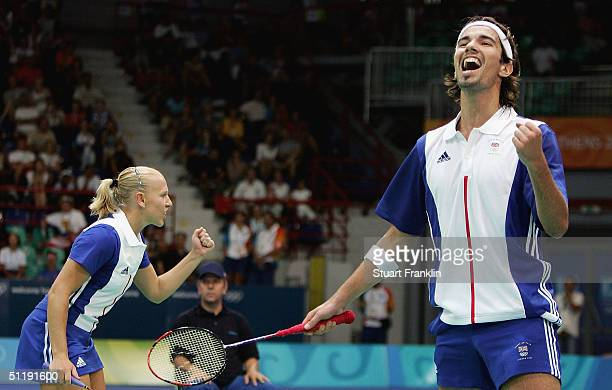 Gail Emms and Nathan Robertson of Great Britain celebrate winning the second set against Jun Zhang and Ling Gao of China in the mixed doubles...
