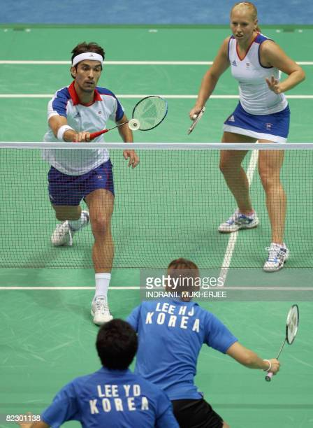 Gail Emms and Nathan Robertson of Great Britain play against Lee Hyojung and Lee Yongdae of South Korea in the mixed doubles quarterfinal badminton...