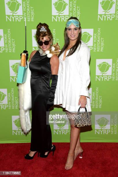 Gail Evertz and Michaela KennedyCuomo attend Bette Midler's Hulaween To Benefit NY Restoration Project at New York Midtown Hilton on October 31 2019...