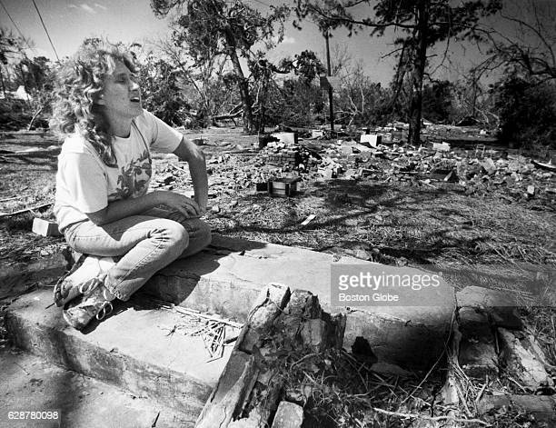 Gail Fuller left sits on the steps to her home where a scattering of debris is all that remains after Hurricane Hugo in McClellanville SC on Oct 3...