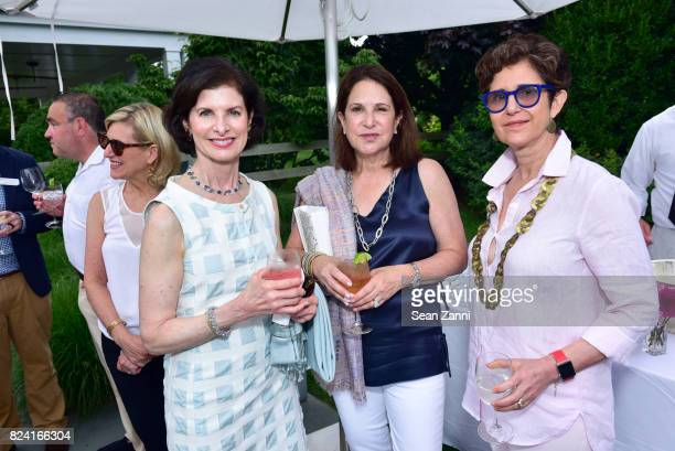 Gail Geronemus, Laura Blankfein and Linda Sirow attend NYSCF Summer Cocktail Reception at a Private Residence on July 28, 2017 in Sagaponack, New...