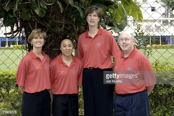 Gail Goestenkors assistant coach Dawn Staley assistant coach Anne Donovan head coach and Mike Thibault assistant coach pose during a portrait session...