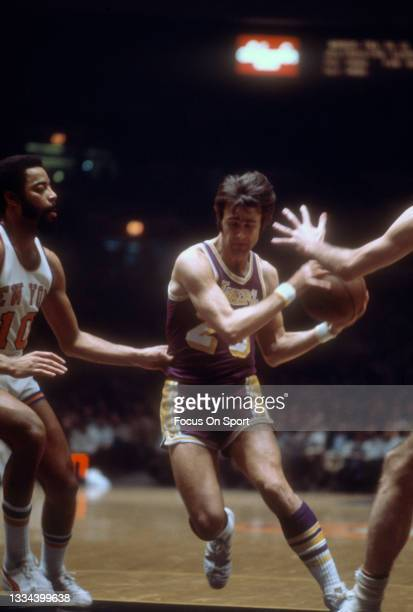 Gail Goodrich of the Los Angeles Lakers drives on Walt Frazier of the New York Knicks during an NBA basketball game circa 1972 at Madison Square...
