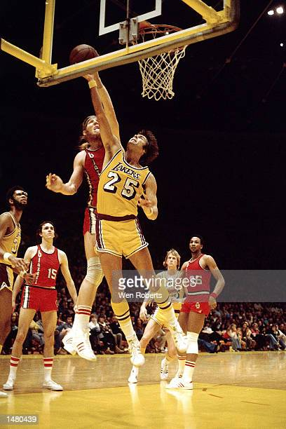 Gail Goodrich of the Los Angeles Lakers goes up for a layup against Bill Walton of the Portland Trail Blazers during an NBA game circa 1976 at the...