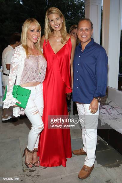 Gail Greenberg Beth Stern and DrStephen Greenberg attend the Social Life Magazine Nest Seekers August Issue Party on August 12 2017 in Southampton...