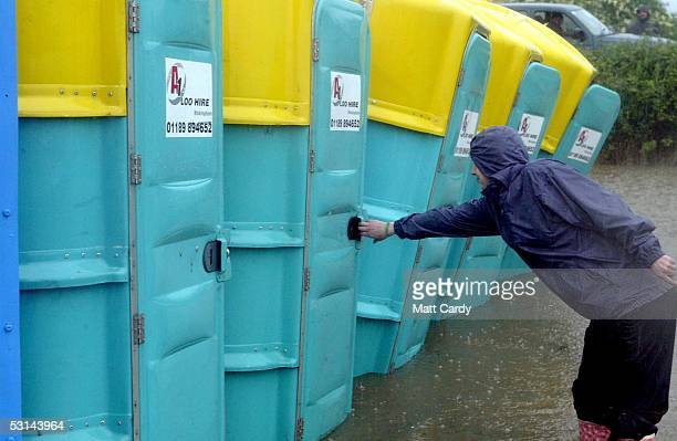 Gail Hamilton tries to use the toilet on the first day of the Glastonbury Music Festival 2005 at Worthy Farm Pilton on June 24 2005 in Glastonbury...