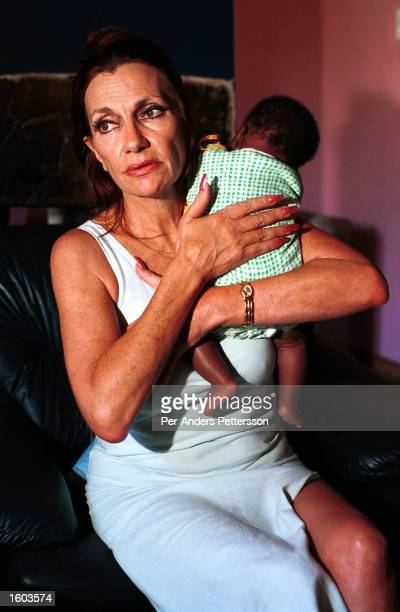 Gail Johnson AIDS activist and founder of Nkosi''s Haven a home for women and children living with HIV or AIDS holds a baby February 3 2001 in...