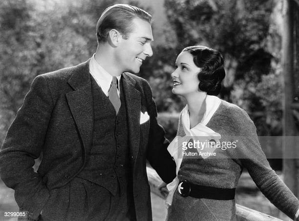 Gail Patrick and Randolph Scott get friendly in a scene from the film 'Murders In The Zoo' directed by A Edward Sutherland for Paramount