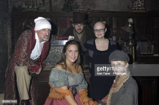 Gail Porter enjoys a moment with Scrooge and other characters at the Kids Company party held at the Victorian Vaults London