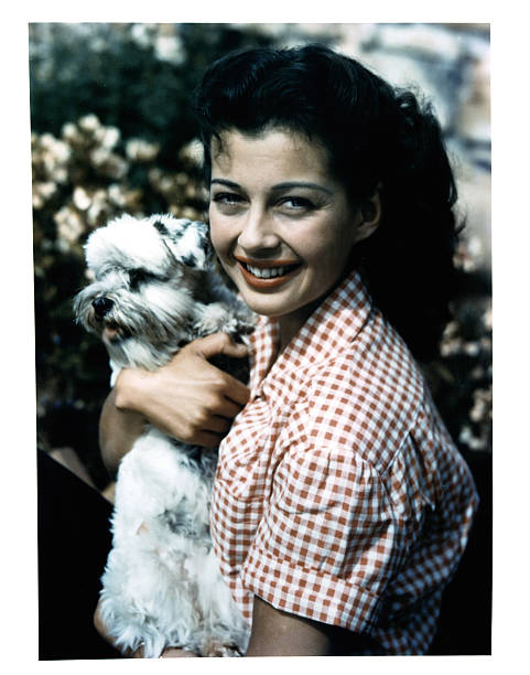 gail-russell-holds-a-dog-in-publicity-po