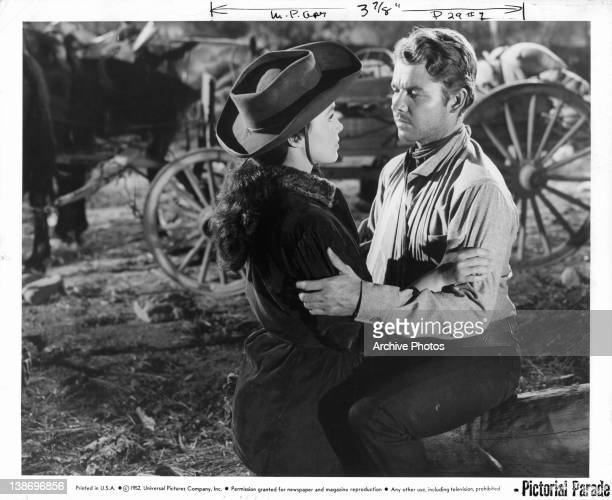 Gail Storm and Audie Murphy embrace in a scene from the film 'The Kid From Texas' 1950