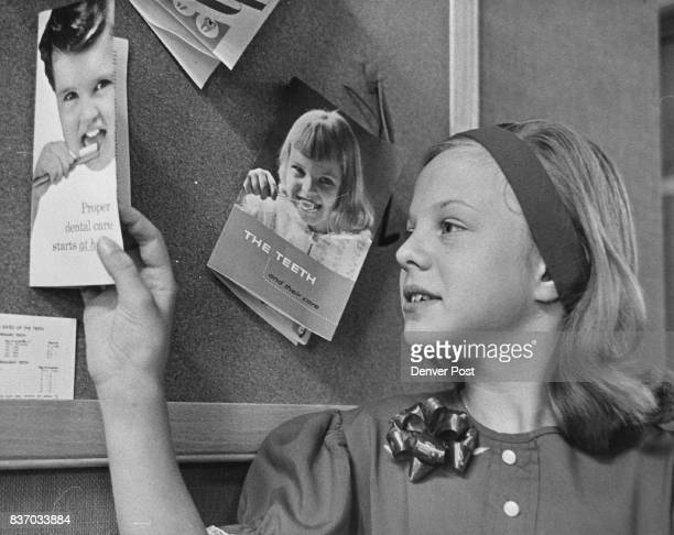 Gail Sveen of 1742 Parker Road looks over some of the literature on the bulletin board at the Arapahoe County Dental Health Clinic while awaiting...