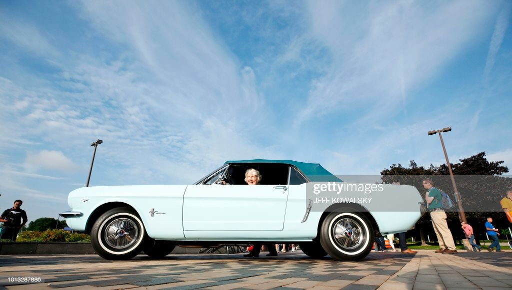 Gail Wise, the original owner, sits in her 1964 Ford Mustang as Ford Motor Company celebrates the production of the 10,000,000 Mustang at their World Headquarters on August 8, 2018 in Dearborn, Michigan. - The Ford Mustang -- an iconic American brand and a symbol of cool -- reached a major milestone Wednesday as the 10 millionth vehicle rolls off an assembly line at a Detroit-area plant. Ford marked the occasion for the car, celebrated in American song and film and recognized the world over as a quintessentially American cultural export, with a big party and parade at the Michigan headquarters.