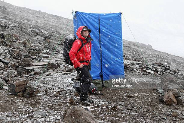 Gails Emms waits to use the toilet at high camp in a snow storm at around 4700m on day five of the Martina Navratilova Mt Kilimanjaro Climb Day One...